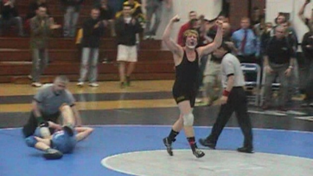 Sauk Rapids-Rice's Chris Keske celebrating after winning his section 8AAA championship match